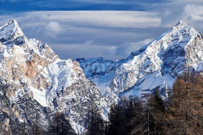 Close up shot of Cortina d'Ampezzo mountains covered in snow at daylight. Italy Stock Photo
