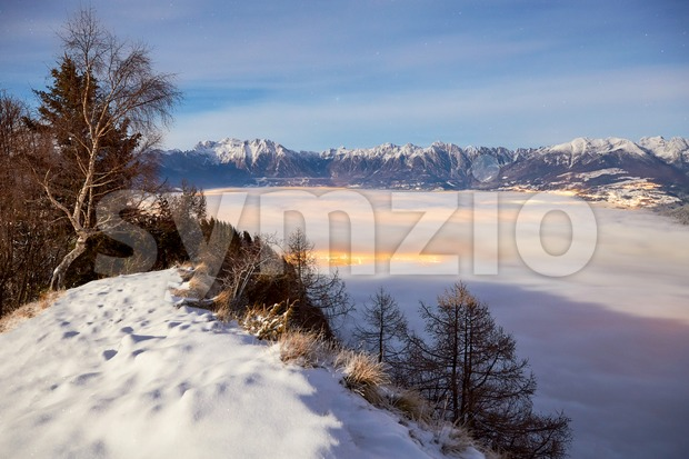 Belluno mountains above clouds at sunset. Italy beauties