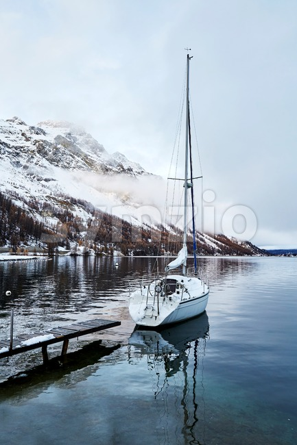 Sailing boat parked on Lake Sils. Cloudy sky. Switzerland