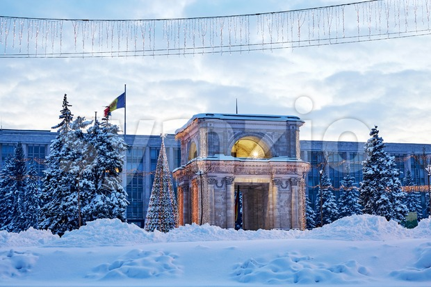 Triumphal arch at sunset in winter season. Chisinau, Moldova Stock Photo