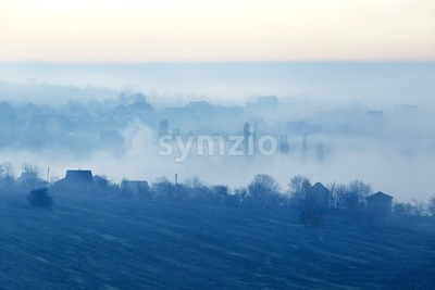 Field covered in fog at sunset. Moldova Stock Photo