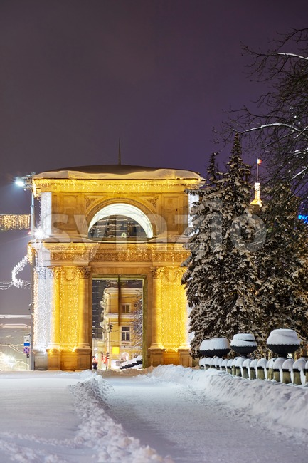 Triumphal arch at night in winter season. Chisinau, Moldova Stock Photo