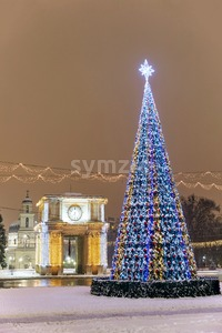 Christmas tree, triumphal arch, bell tower and cathedral at night. Chisinau, Moldova Stock Photo