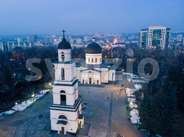 Aerial drone view of chisinau city center at night with lights and blue sky, nativity cathedral, Moldova Stock Photo
