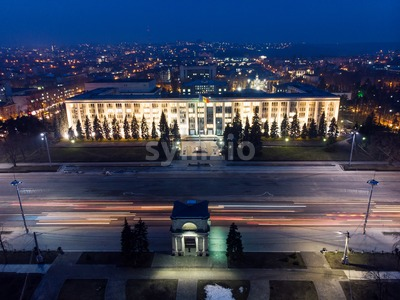 Aerial drone view of chisinau city center at night with light and blue sky, government building and arch, Moldova Stock Photo