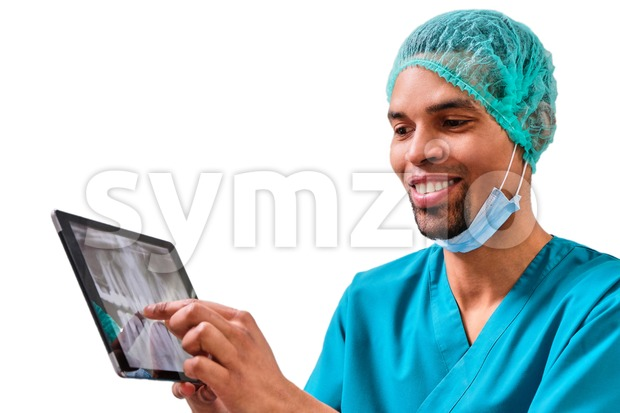 African male dentist explaining x-ray to the patient sitting in the chair. Isolated background