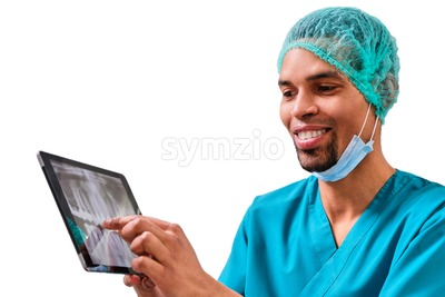 African male dentist explaining x-ray to the patient sitting in the chair. Isolated background Stock Photo