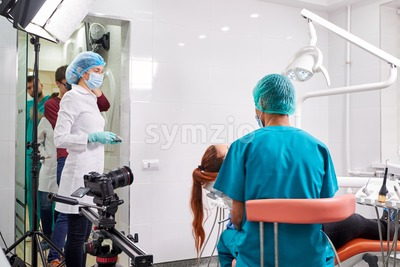 Shooting crew in dental cabinet. Camera ready to shoot Stock Photo