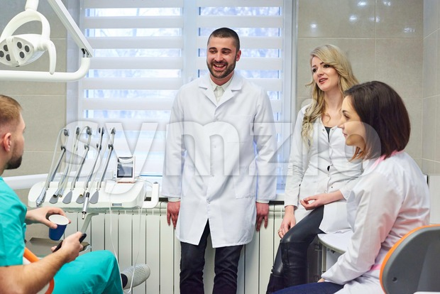 Young caucasian dentists on coffee break. Smiling and talking Stock Photo