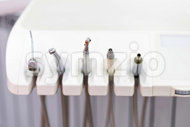 Close up shot to some dentistry tools. Modern looking medical equipment in the cabinet. Healthcare idea Stock Photo